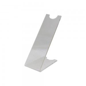 A small slanted acrylic shoe rest.