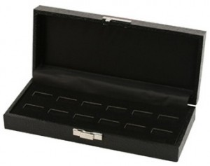Black 12 wide slot ring case.  Lid snaps closed. Sold as Each.